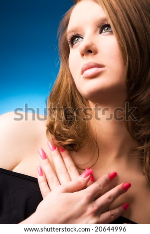 Young woman portrait. On blue background.