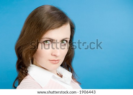 Young Woman Portrait Over Blue