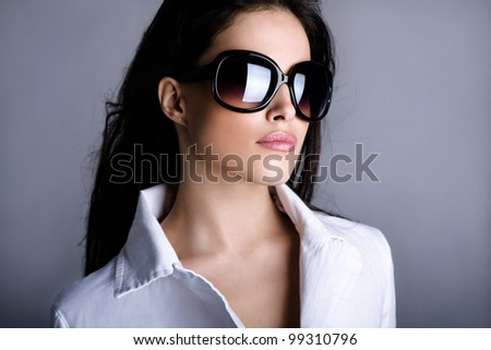 young woman portrait with big fashion sunglasses, studio shot