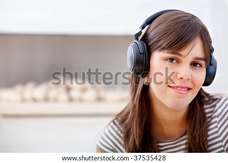 Young Woman portrait with headphones and smiling
