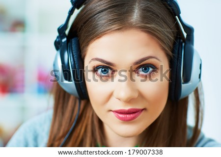 Young woman portrait with headphones music listening. Beautiful girl.