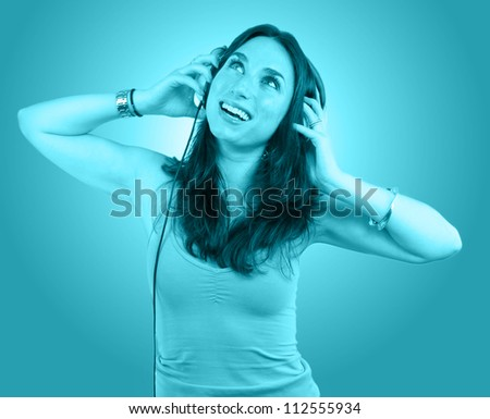 Young  woman portrait with headphones tinted in blue