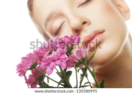 Young woman portrait with pink chrysanthemum. Spa treatment.