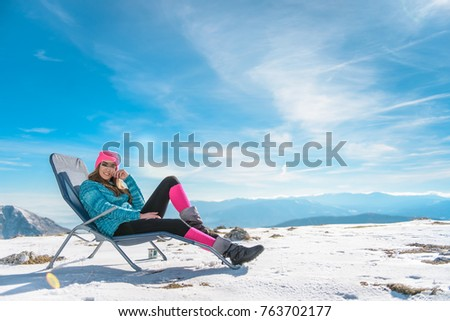 Young woman poses and enjoy at the snowy mountain #763702177