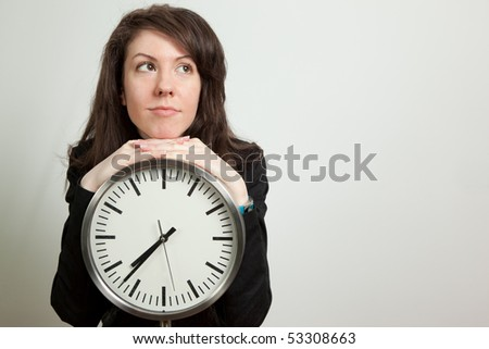 Young woman posing by clock. Isolated on white