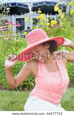 Young woman posing for the camera in a straw hat