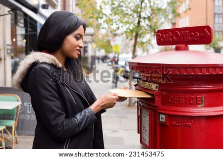 young woman posting a letter