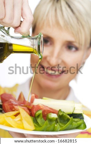 young woman pouring olive oil close up