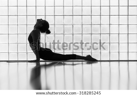 Young woman practicing in a yoga studio. Upward facing dog during sun salutations.