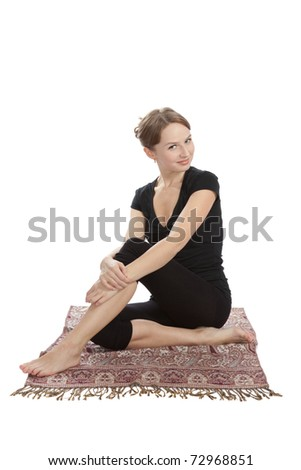 Young woman practicing Yoga exercises. Yoga and fitness. - stock photo