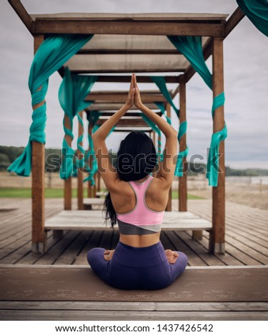 Young woman practicing yoga outdoor