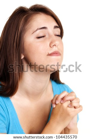 young woman praying - stock photo