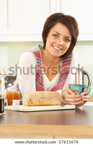 Young Woman Preparing Breakfast In Modern Kitchen