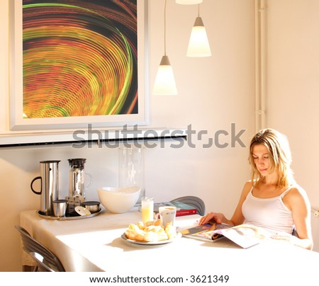 Young woman preparing morning coffee and reading magazines