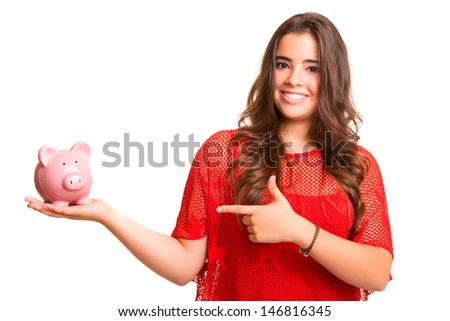 Young woman presenting a piggy bank (money box) - savings concept - stock photo