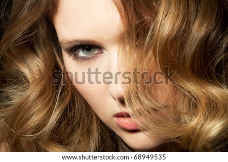 young woman presents her golden locks