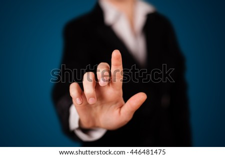 Young woman pressing imaginary button #446481475