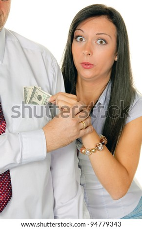 young woman pulls a man out of his pocket money. dollar