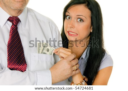 Young woman pulls a man out of the money.Dollar - stock photo