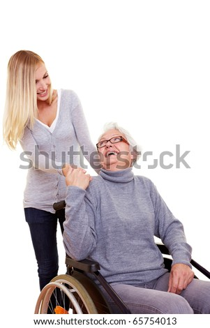 Young woman reaching out to an elderly handicapped woman