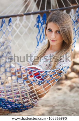 Young woman read the book in the hammock