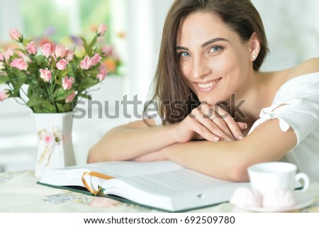 young woman reading book #692509780