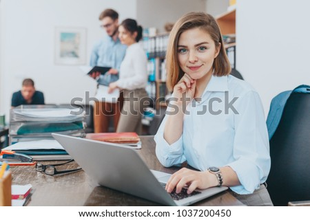 Young woman reading email at the office