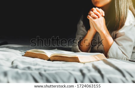 Young woman reading the holy bible in morning, worship and pray.devotion concept. Stockfoto ©