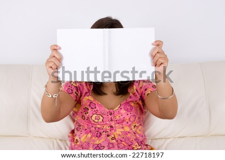 young woman reading white book