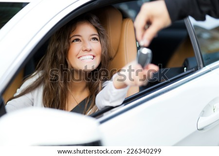 Young woman receiving the keys of her new car #226340299