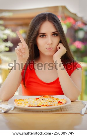 Young Woman Refusing  To Eat a Pizza - Beautiful girl saying no to fast food