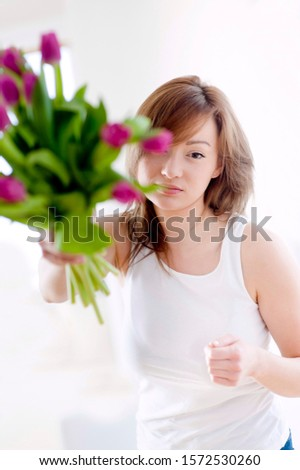 Young woman rejecting bunch of flowers