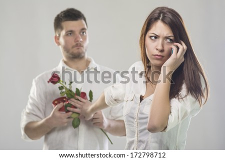 Young woman rejecting gifts from her boyfriend