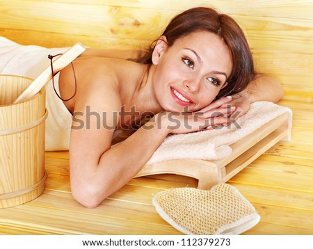 Young woman relax sauna. Weight loss.
