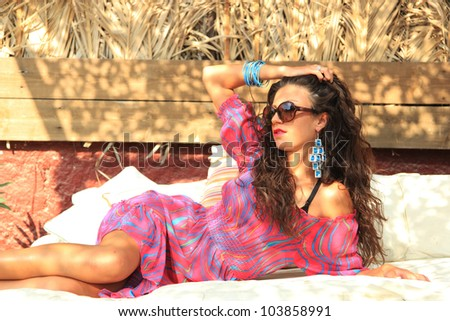 Young woman relaxing at summer lounge bar