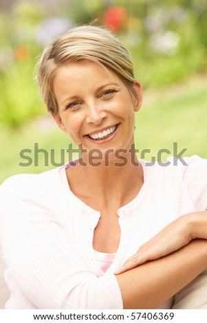 Young Woman Relaxing In Garden