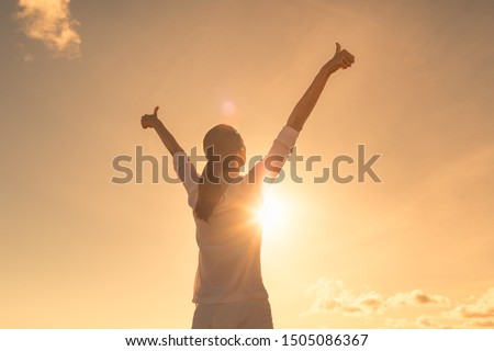 Young woman relaxing in summer sunset sky outdoor. People freedom, feeling, positive lifestyle.