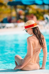 Young woman relaxing in swimming pool.