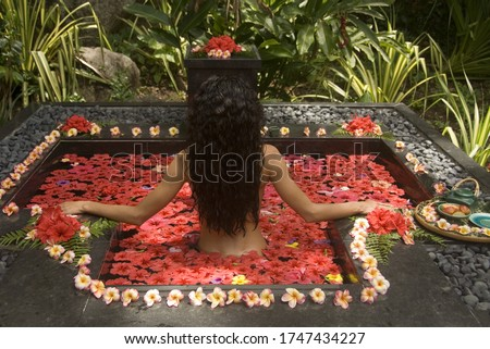 Young woman relaxing in tranquil spa
