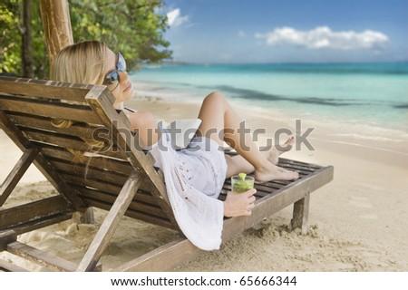Young woman relaxing on a beautiful Caribbean beach.