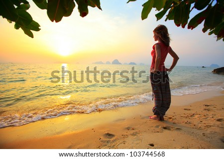 Young woman relaxing on a tropical beach