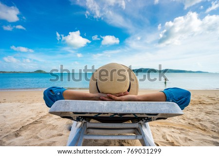 Young woman relaxing on beach, ocean view, Vacation Outdoors Seascape Concept #769031299