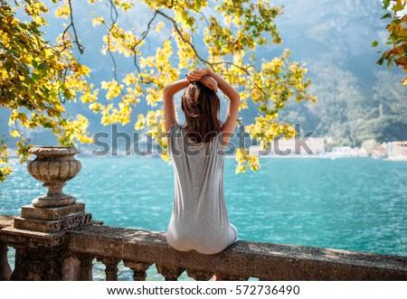 Young woman relaxing on beautiful Garda lake. vacation concept #572736490