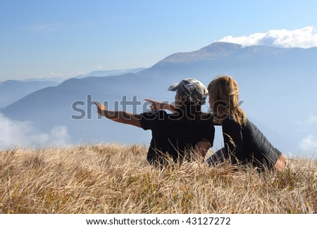 Young woman relaxing on mountain meadow