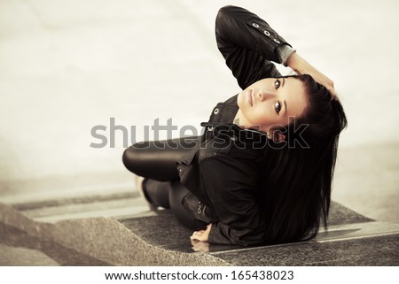 Young woman relaxing on the city sidewalk
