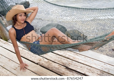 Young woman resting on a hammock
