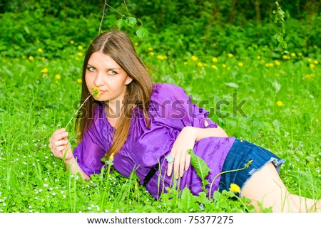 young woman resting on meadow