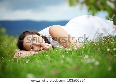 Young woman resting outdoors