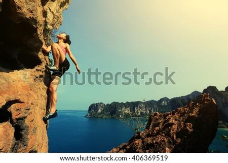 young woman rock climber...