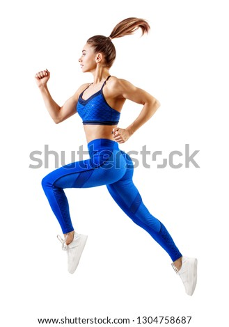 Young woman runner in blue sportswear jump in the air. Dynamic movement. #1304758687